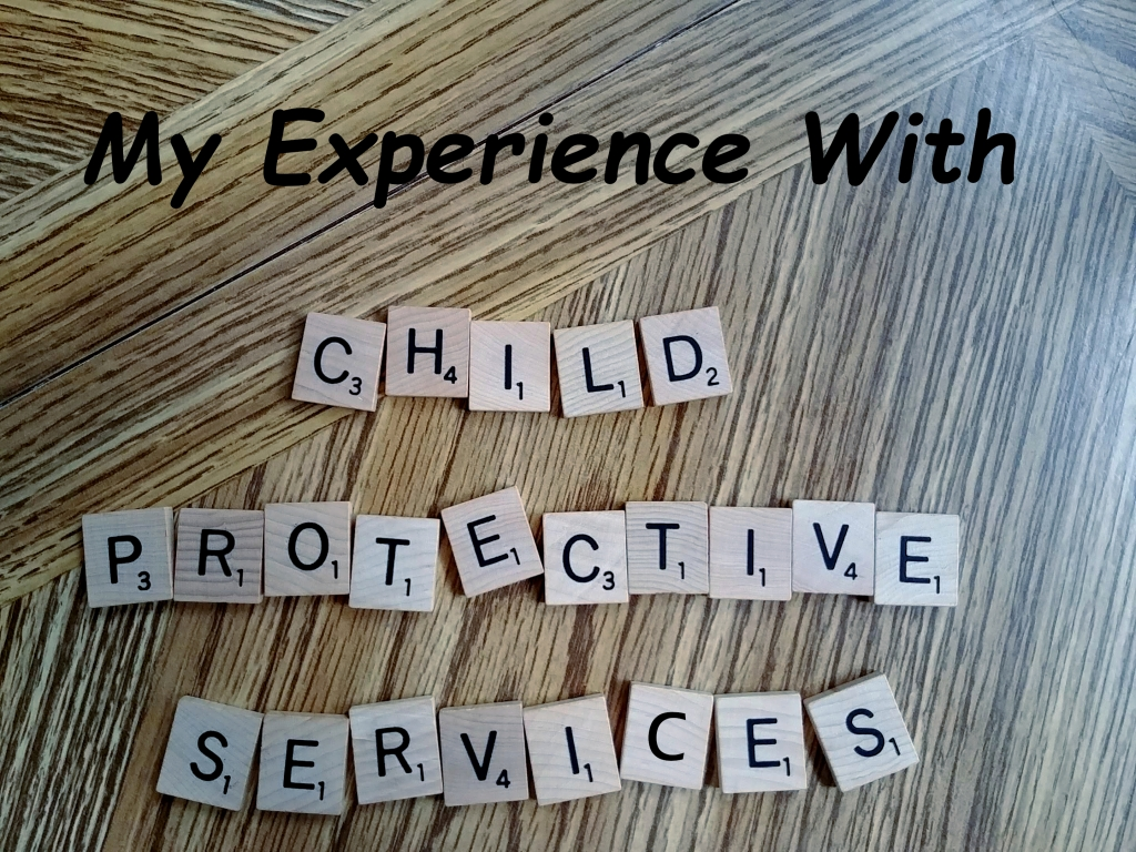 Child Protective Services spelled out with scrabble letters on wood table