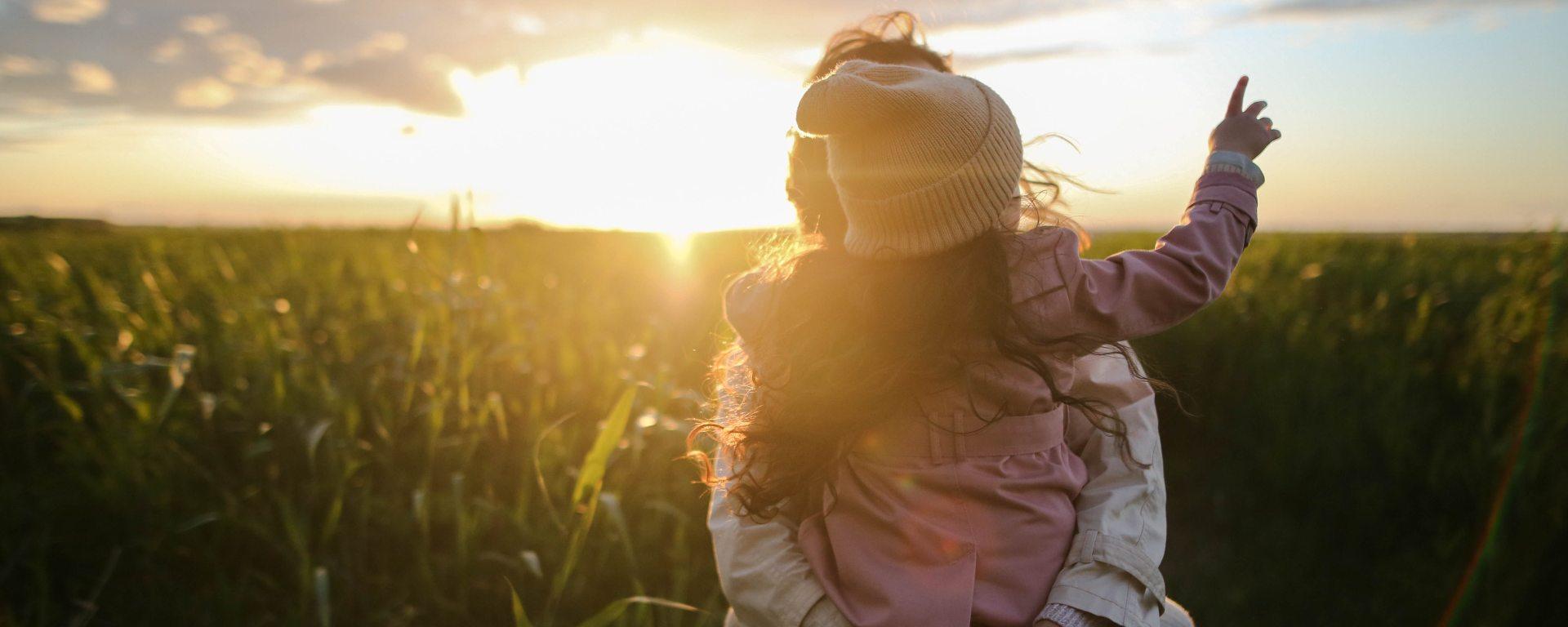 adult-child-daughter-sunset