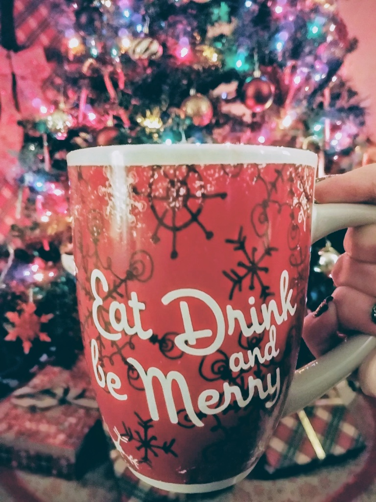 Eat Drink and Be Merry Tea Cup with Christmas Tree in background