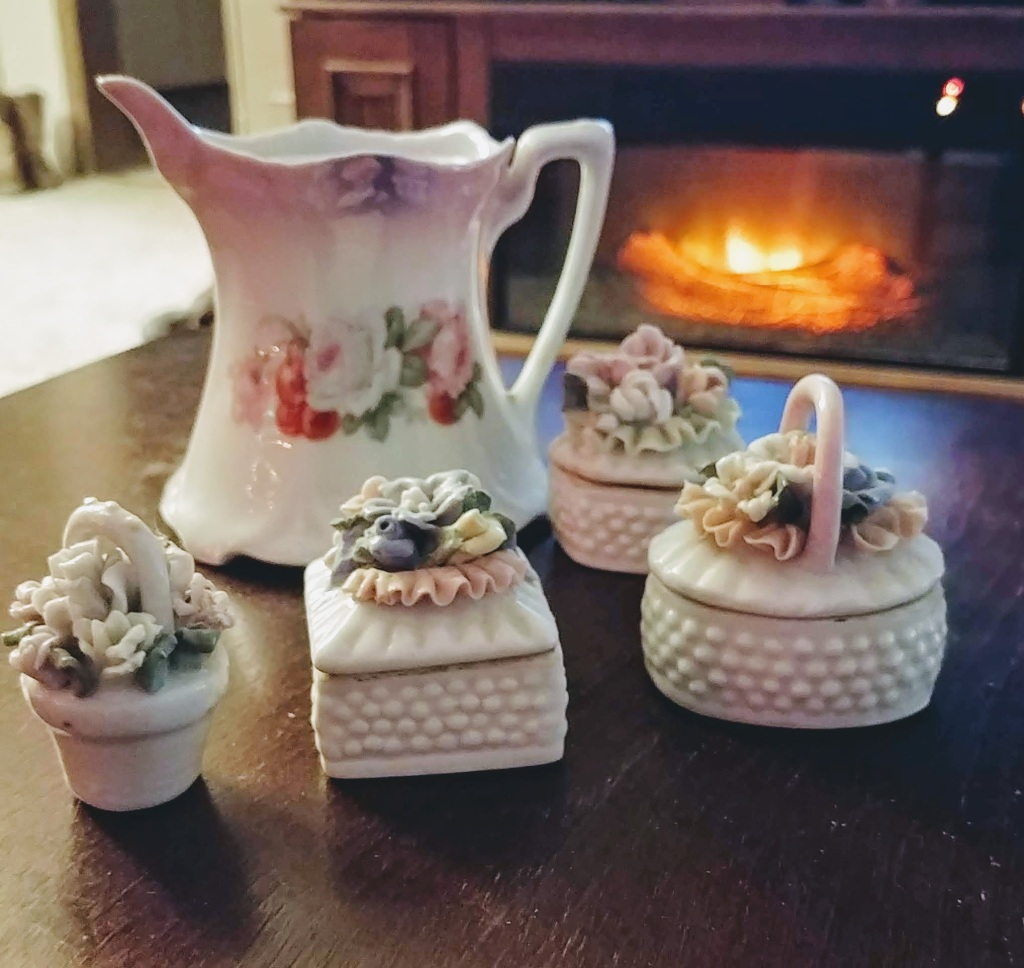 Vintage Orla Germany Porcelain on table in front of fire