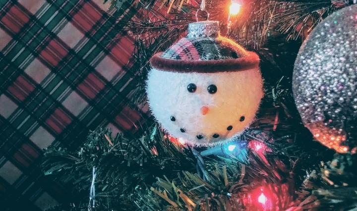Snowman Face Ornament On Christmas Tree